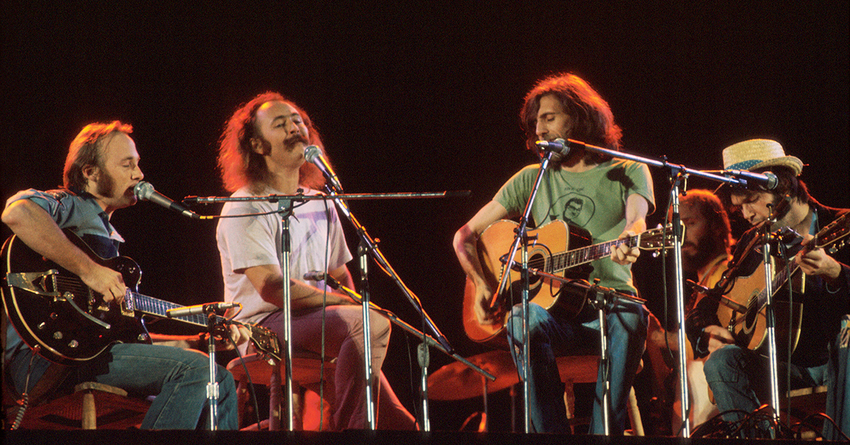 Crosby Stills Nash and Young perform on stage at Wembley Stadium, London, 14th September 1974, L-R Stephen Stills, David Crosby, Graham Nash, Neil Young. (Photo by Michael Putland/Getty Images)